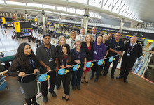 Colleagues Celebrating Living Wage Week (all paid LLW&above) - Cheif People Officer Paula Stannett with Heathrow colleagues, including represenatives from Wilson James, Mitie and Omniserve.