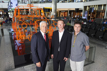 L-R - Normand Bovin (Heathrow's Chief Operating Officer), Benedict Radcliffe (Artist) and Paul Brennan (London taxi driver)