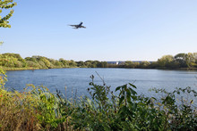 Aircraft flying over lake